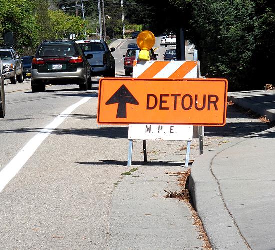 Detour sign blocking bike lane