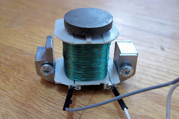 Coil (about 0.5H) with refrigerator magnet on top.  Magnet is stuck to the core of the coil just by its own magnetism.