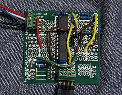Instrumentation amplifier protoboard with circuit wired for the pressure sensor lab (top left connector to pressure sensor, bottom center connect or to Arduino)