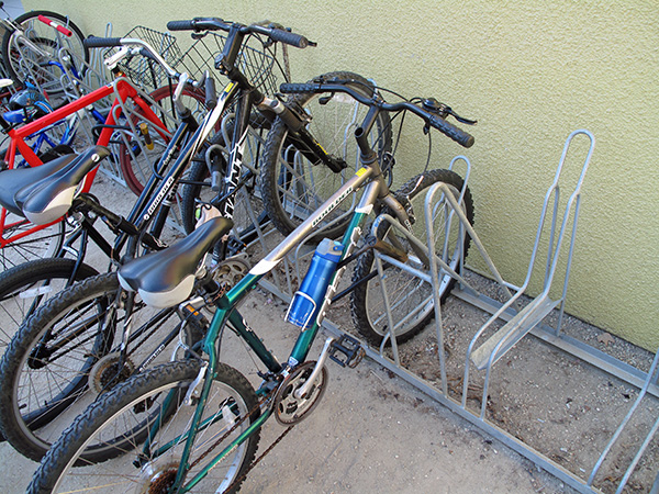 Most of the bike parking is of a style that alternates high and low, intended for allowing tight packing of the bikes without handlebars interfering.  There is an adequate locking point for the frame, but not for the rear wheel.