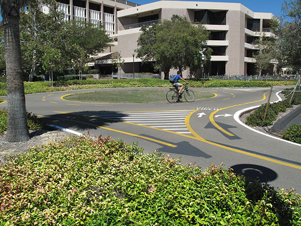 UCSB has bike paths on which bicyclists have priority over pedestrians, and traffic is heavy enough during the school year that they found it useful to put roundabouts at a couple of the major intersections of bike paths.