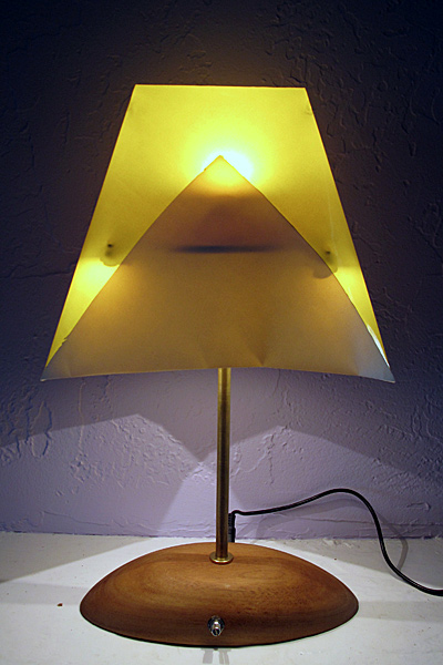 When turned on, the lamp produces a modest downward light and illuminates the shade.