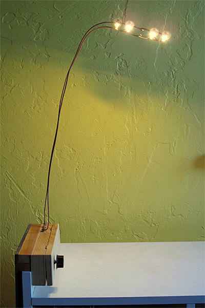 Here is a side view of the desk lamp showing the hook for sliding over the bed rail.  I've only populated 4 of the 5 positions for LED boards.
