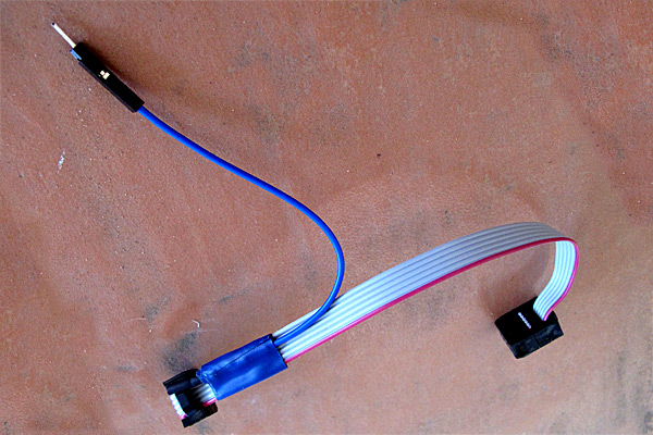 The electrical tape stabilizes the splice and the crimp-on female header allows connecting to male or female headers on the Arduino board. Here there is a double-ended male header pin in the female header, to convert it to a male header.