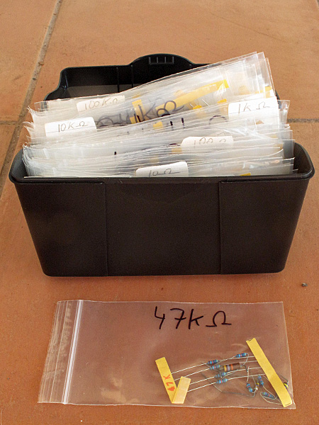 Box with about 120 different sizes of resistors, from 0.5Ω to 5.6MΩ.