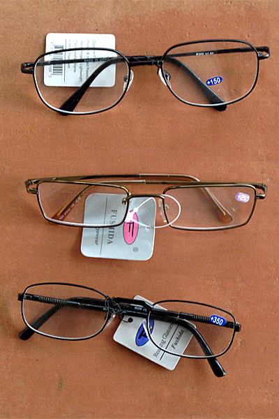 Three pairs of reading glasses at $2 each.