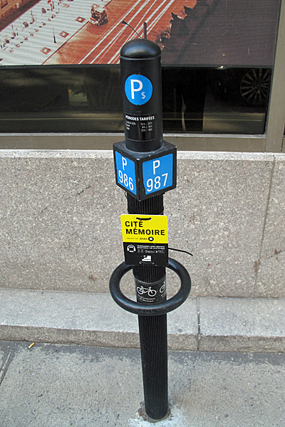 There are parking posts like this one all over Montreal, numbering the parking spaces for payment, but only a few of them have the extra ring for locking bicycles to the post.