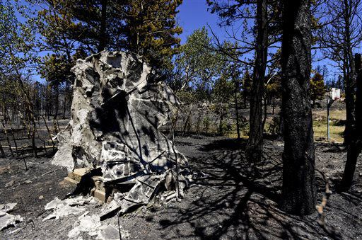 The remains of a satellite dish melted in a wildfire are seen near the home of Lester Karplus and Karna Knapp in Nederland, Colo., on Tuesday, July 12, 2016. (Matthew Jonas/Daily Camera via AP)[http://www.starherald.com/news/regional_statewide/colorado-wildfire-forces-evacuations-of-over-homes/article_ad0266d0-11a6-5c88-a397-2ae503cda789.html?mode=image]