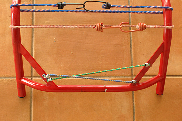 The bungee cords provided a fairly large clamping force, but no more glue oozed out when it was added, so the springiness of the frame alone may have been sufficient.