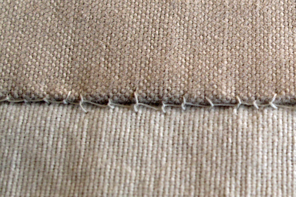 The blanket stitch is a somewhat decorative treatment for a patch edge, but I worry that it may snag too easily.