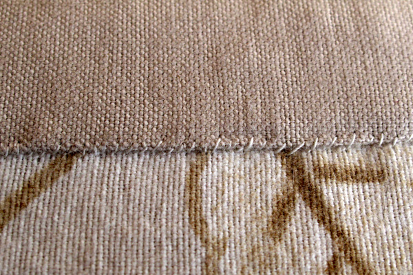 Whip stitch is the simplest way to attach two pieces of fabric when you only have access to one side.